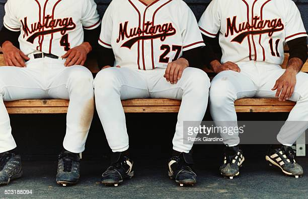 baseball players sitting on bench - sports dugout stock pictures, royalty-free photos & images