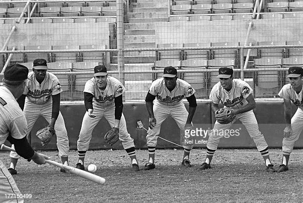 Portrait of Baltimore Orioles Willie Kirkland Russ Snyder Joe Gaines Bob Saverine and Bob Johnson posing while playing pepper during spring training...
