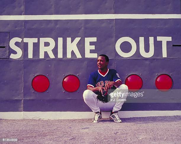 Baseball Portrait of Boston Red Sox Pedro Martinez in front of Green Monster STRIKE OUT scoreboard at Fenway Park stadium Boston MA 7/18/1999