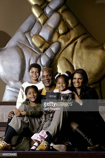 Portrait of former MLB outfielder Darryl Strawberry with family 9yearold son Jordan 8yearold daughter Jade 3yearold daughter Jewel and his wife...