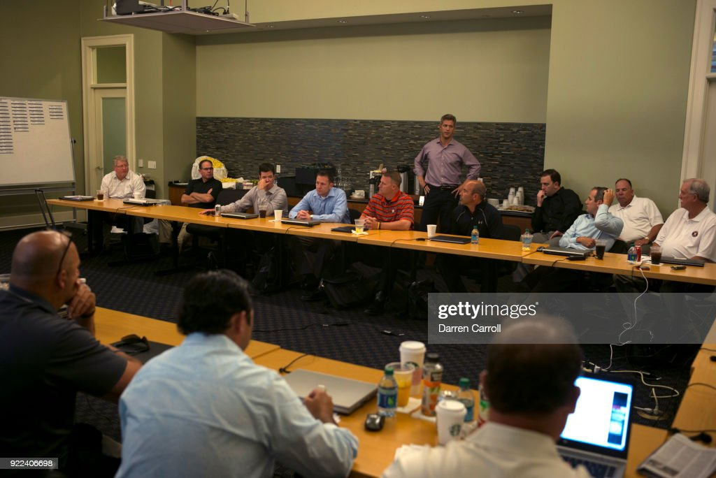 Portrait of Houston Astros director of amateur scouting Mike Elias with scouts and analysts in war room during MLB Draft Day at Minute Maid Park. Behind the Scenes. Darren Carroll TK1 )