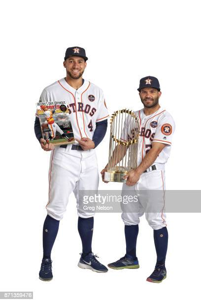 Portrait of Houston Astros George Springer and Jose Altuve posing during photo shoot at Minute Maid Park Altuve is holding Commissioner's Trophy and...