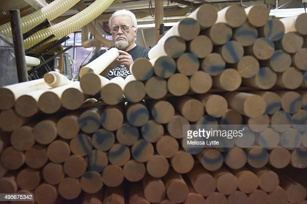 Portrait of Louisville Slugger craftsman Danny Luckett examining bat during photo shoot at Louisville Slugger Museum Factory Equipment Luckett is...