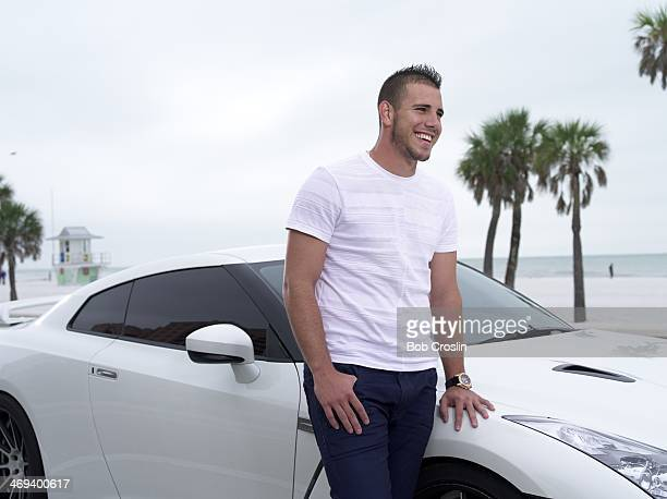 Portrait of Miami Marlins pitcher Jose Fernandez posing during photo shoot at South Beach Clearwater FL CREDIT Bob Croslin