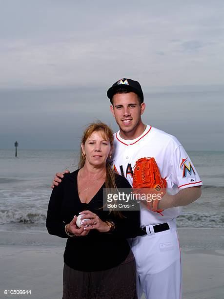Portrait of Miami Marlins pitcher Jose Fernandez posing with his mother Maritza Fernandez during photo shoot on South Beach Jose rescued Maritza from...