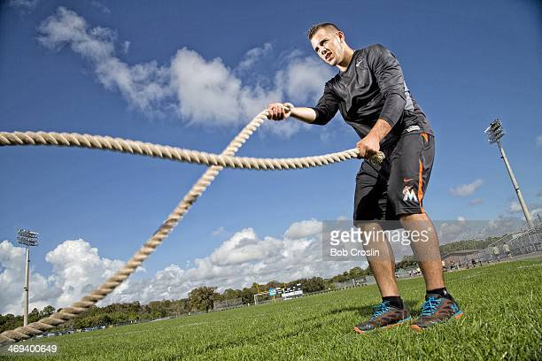 Portrait of Miami Marlins pitcher Jose Fernandez using ropes during training session photo shoot at Braulio Alonso HS Tampa FL CREDIT Bob Croslin
