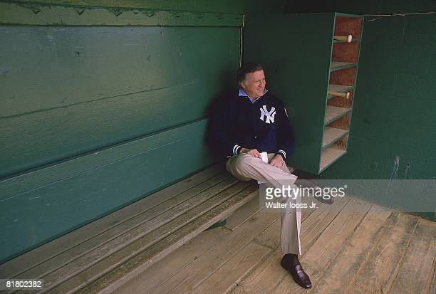 Baseball Portrait of New York Yankees owner George Steinbrenner sitting in dugout during spring training FL 3/2/1984