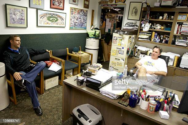 Portrait of Oakland Athletics general manager Billy Beane and Boston Red Sox general manager Theo Epstein sitting in Beane's office before game at...