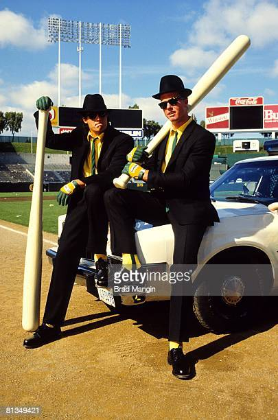 Baseball Portrait of Oakland Athletics Jose Canseco and Mark McGwire dressed up like Blues Brothers Oakland CA 7/25/1987