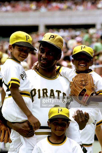 Portrait of Pittsburgh Pirates Roberto Clemente with his children sons Luis Roberto Roberto Jr and Enrique Roberto before game vs San Diego Padres at...