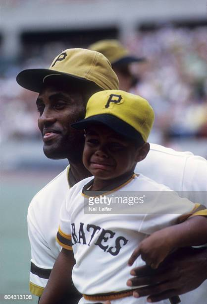 Portrait of Pittsburgh Pirates Roberto Clemente with his son Enrique Roberto before game vs San Diego Padres at Three Rivers Stadium Pittsburgh PA...