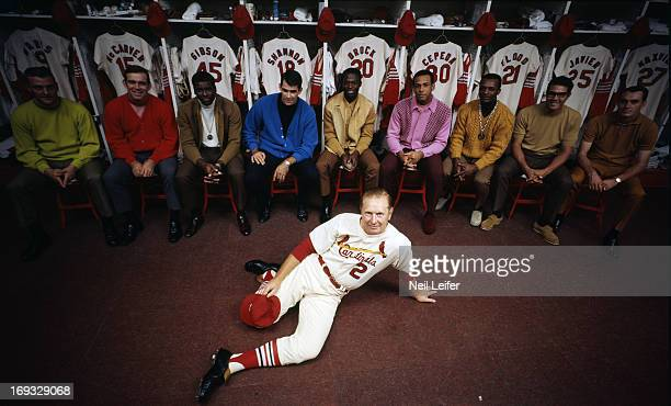 Portrait of St Louis Cardinals manager Red Schoendienst casual with team Roger Maris Tim McCarver Bob Gibson Mike Shannon Lou Brock Orlando Cepeda...