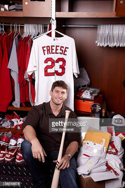 Portrait of St Louis Cardinals third baseman David Freese casual with his jersey and fan mail during photo shoot in the locker room of Busch Stadium...