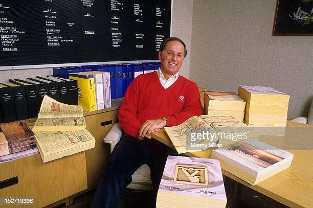 Portrait of Toronto Blue Jays general manager Pat Gillick with Yellow Pages telephone books in his office during photo shoot at Exhibition Stadium...