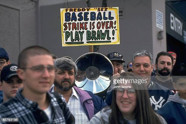 Post MLB Strike: View of fan outside Yankee Stadium with FREDDY SEZ BASEBALL STRIKE IS OVER PLAY BAWL! sign before New York Yankees vs Texas Rangers...