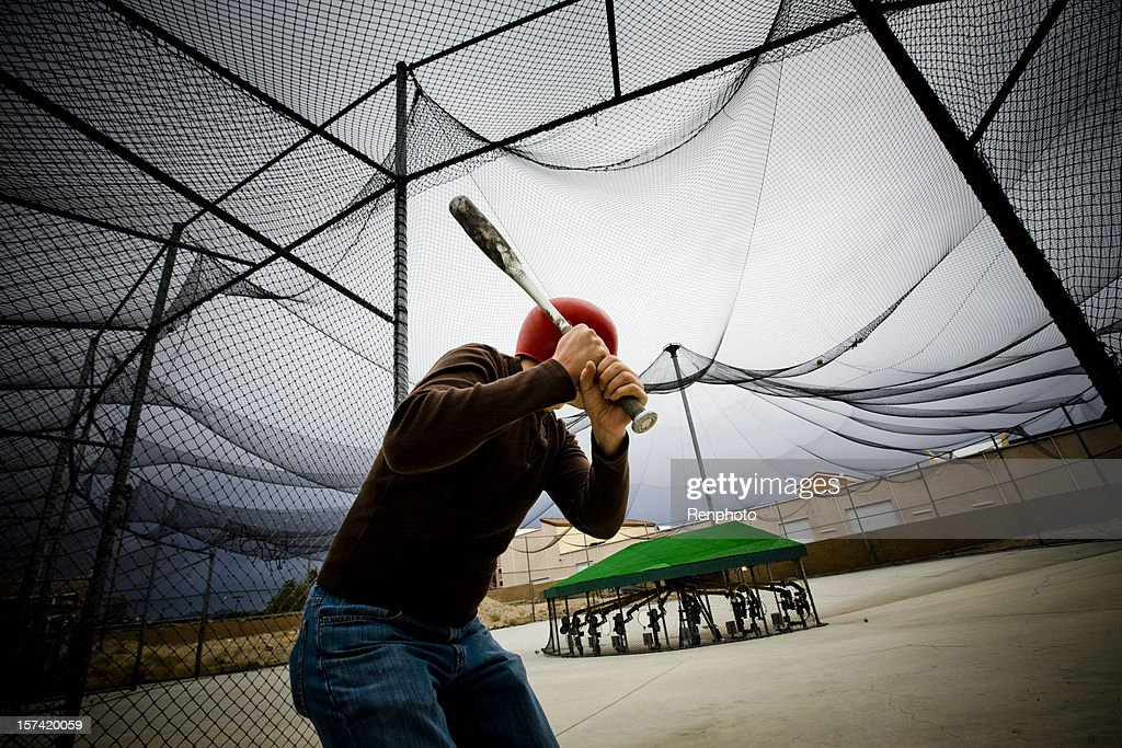Baseball Practice: Man at Batting Cages : Stock Photo