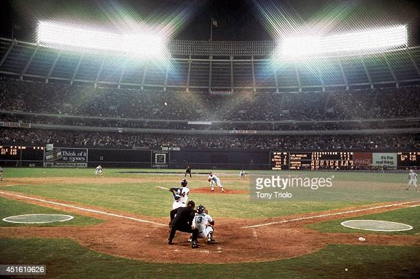 Rear view of Atlanta Braves Hank Aaron in action at bat hitting his 715th career home run and breaking Babe Ruth's record vs Los Angeles Dodgers at...
