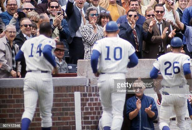 Rear view of Chicago Cubs Ernie Banks Ron Santo and Billy Williams victorious returning to dugout after home run during game vs Cincinnati Reds at...