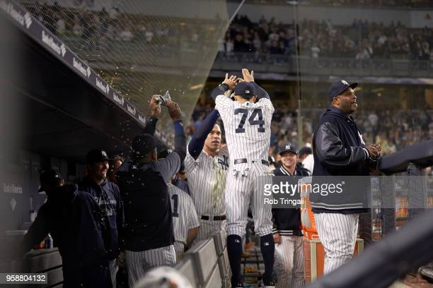 Rear view of New York Yankees Ronald Torreyes victorious with Aaron Judge in dugout during game vs Boston Red Sox at Yankee Stadium Bronx NY CREDIT...