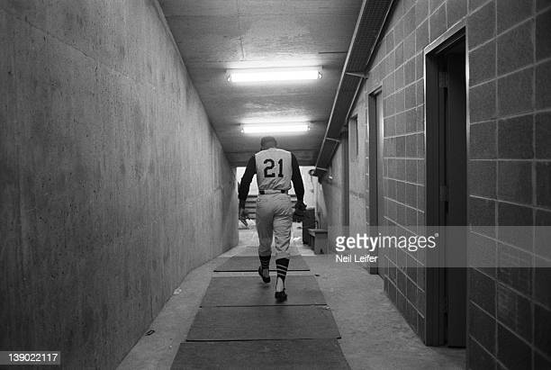 Rear view of Pittsburgh Pirates Roberto Clemente walking in tunnel beneath stands before game vs St Louis Cardinals at Civic Center Busch Memorial...