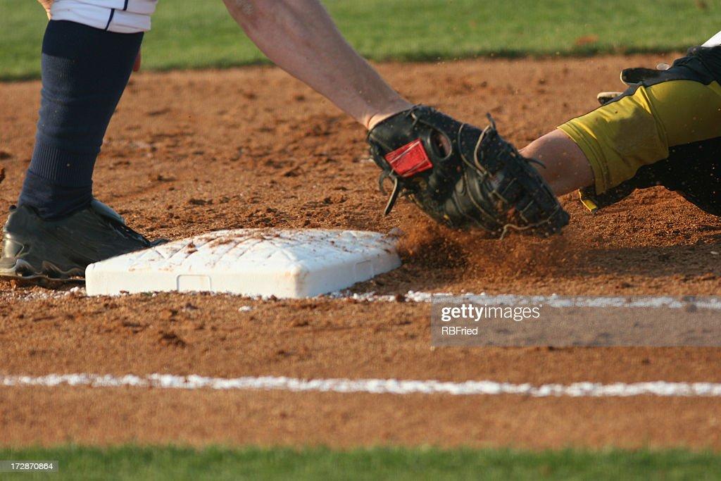 Baseball runner sliding into third base : Stock Photo