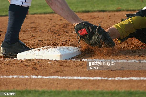 Baseball runner sliding into third base
