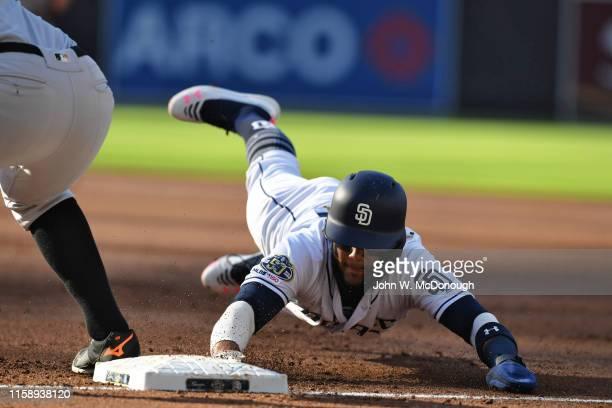 San Diego Padres Fernando Tatis Jr. In action, diving back into first base vs San Francisco Giants Petco Park. San Diego, CA 7/27/2019 CREDIT: John...
