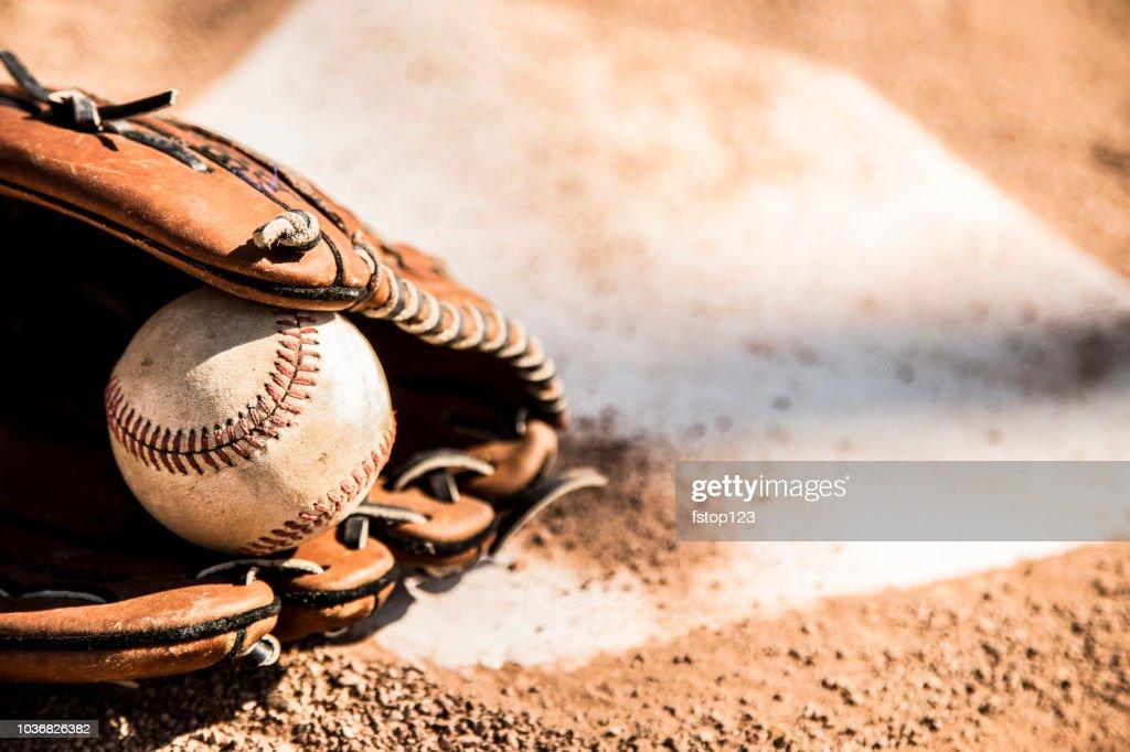 Baseball season is here.  Glove and ball on home plate. : Stock Photo