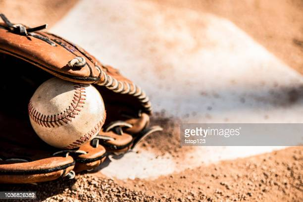 baseball season is here.  glove and ball on home plate. - baseball sport stock pictures, royalty-free photos & images