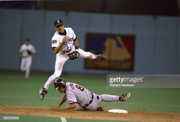 Seattle Mariners Rich Amaral in action, turning double play vs Baltimore Orioles Cal Ripken Jr. . Seattle, WA 4/28/1994 CREDIT: Richard Mackson