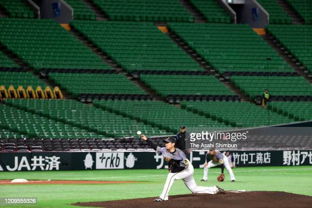 Baseball spring training game between Fukuoka SoftBank Hawks and Hanshin Tigers is held behind closed doors amid increasing fear of COVID-19 new...
