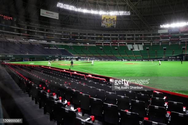 Baseball spring training game between Fukuoka SoftBank Hawks and Hanshin Tigers is held behind closed doors amid increasing fear of COVID-19 new...