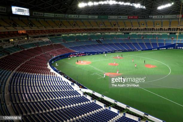 A baseball spring training game between Hiroshima Toyo Carp and Chunichi Dragons is held behind closed doors amid increasing fear of COVID19 new...