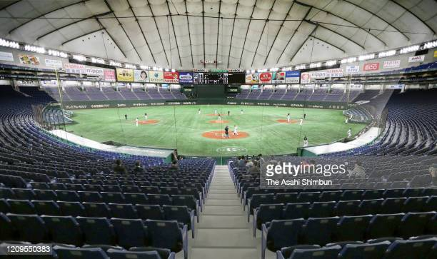 Baseball spring training game between the Yomiuri Giants and Yakult Swallows is held behind closed doors amid increasing fear of COVID-19 new...