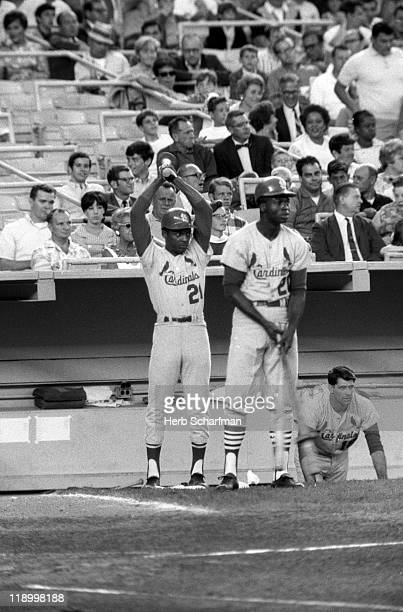 St Louis Cardinals Curt Flood and Lou Brock on deck during game vs New York Mets at Shea Stadium Flushing neighborhood of the Queens borough of New...
