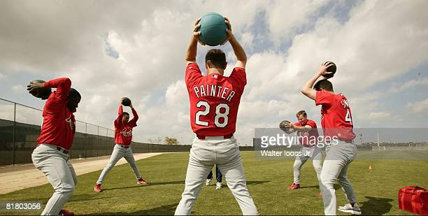 Baseball St Louis Cardinals Lance Painter in action with medicine ball and teammates during spring training Jupiter FL 2/15/2003