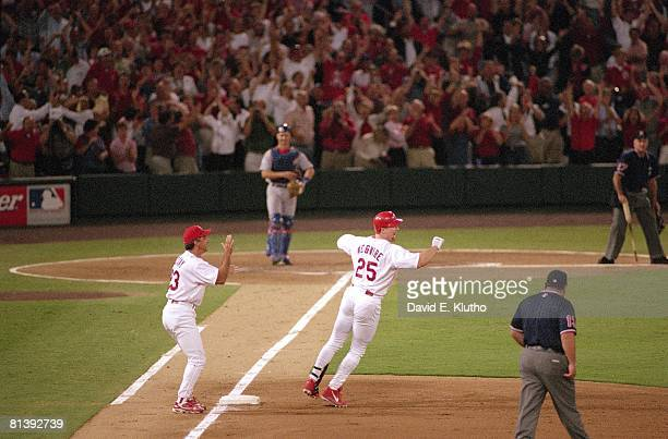 Baseball St Louis Cardinals Mark McGwire in action and victorious rounding first base after hitting 62nd season HR and breaking Roger Maris record...