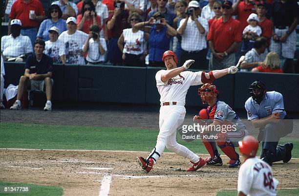 Baseball St Louis Cardinals Mark McGwire in action hitting 70th season HR during game vs Montreal Expos Carl Pavano St Louis MO 9/27/1998