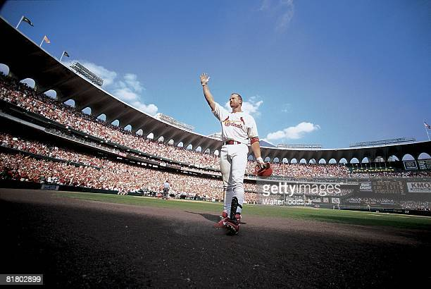 Baseball St Louis Cardinals Mark McGwire victorious after hitting 70th season HR during game vs Montreal Expos View of Busch Stadium St Louis MO...