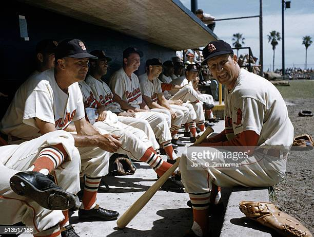 St Louis Cardinals Stan Musial in dugout with teammates during spring training Florida 3/1/1957 CREDIT John G Zimmerman