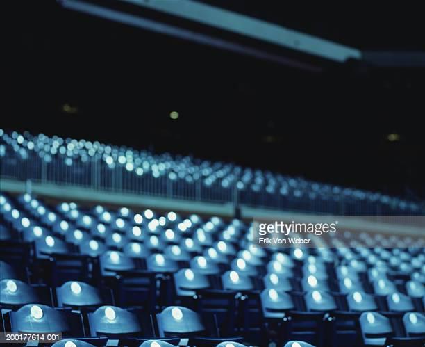 Baseball stadium seats at night (defocussed)