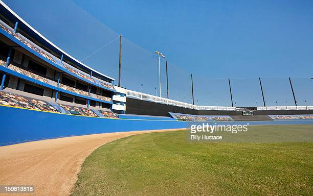 A baseball stadium with grass and dirt outfield