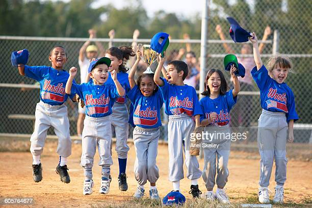 baseball team cheering on field - baseball uniform stock pictures, royalty-free photos & images
