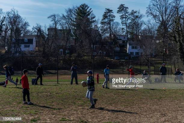 BCC baseball team practices on a baseball field adjacent to the Drumaldry neighborhood in Bethesda MD on March 01 2020