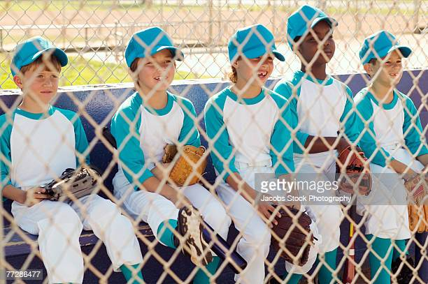 baseball team sitting in dugout - sports dugout stock pictures, royalty-free photos & images
