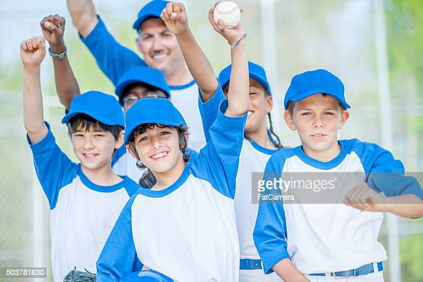 baseball team standing together - baseball team stock pictures, royalty-free photos & images