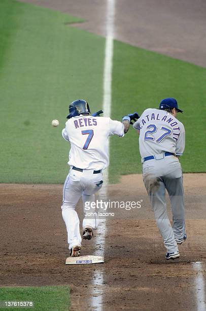 Texas Rangers Frank Catalanotto and New York Mets Jose Reyes in action avoiding overthrown ball at Shea Stadium Game 2 of doubleheader Flushing NY...