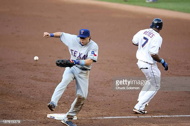Texas Rangers Frank Catalanotto in action attempting to field overthrown ball vs New York Mets Jose Reyes at Shea Stadium Game 2 of doubleheader...