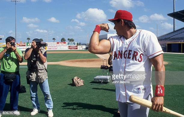 Texas Rangers Jose Canseco flexing his bicep showing is scar during spring training at Charlotte Sports Park. Scar is due to Tommy John elbow...