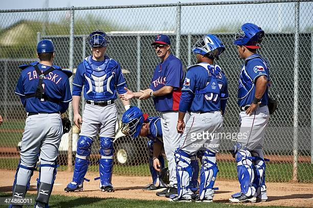 Texas Rangers pitching coach Mike Maddux with catchers during spring training workout at Surprise Recreation Campus Surprise AZ CREDIT John Biever